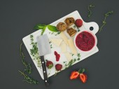 Cheese and fruit set on a dark surface — Stock Photo