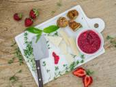 Cheese and fruit set on a wooden surface — Stock Photo