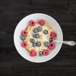 Oat porridge with fresh raspberry, blueberry and honey — Stock Photo #60051679