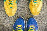 Two pairs of bright sport shoes standing in front of each other — Stock Photo