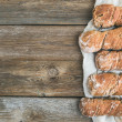 Freshly baked rustic  village bread (baguettes) set on rough woo — Stock Photo #60388717
