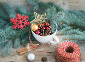 Christmas (New Year) decoration set: a cup full of colrful Chris — Stock Photo