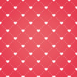 Seamless pattern of hearts on a red background — Stock Vector #64001789