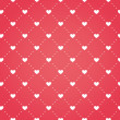 Seamless pattern of hearts on a red background — Stock Vector #64471929