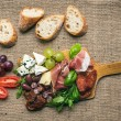 Cheese and meat platter with fresh grapes, cherry-tomatoes, oliv — Stock Photo #68759967