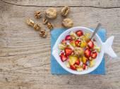 A bawl of fruit, walnuts and yogurt — Stock Photo
