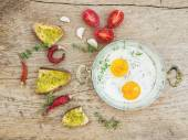 Breakfast set with roasted eggs, bread toasts with pesto souce,  — Stock Photo