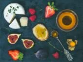 Cheese, fresh strawberries, figs, raspberries, ground cherry, th — Stock Photo