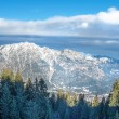 The view over the Bavarian Alpine slopes covered with snow from — Stock Photo #68761729