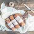 Freshly baked rustic village bread (baguettes) wrapped in paper — Stock Photo #68762867