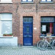 Bicycles parked at the entance of the old medieval red brick hou — Stock Photo #68763197