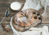 Village style breakfast set: sweet cinnamon ring bread and a cup — Stock Photo