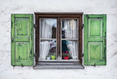 Authentic window with green wooden shuttters in a small town of — Stock Photo