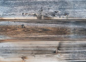 Old rough discolored wooden texture — Stock Photo