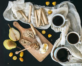 Breakfast - coffee break set: a pot cezve of coffee, two cups — Stock Photo