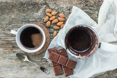 Coffee set. Cezve - coffee pot, with freshly brewed coffee, a cup, bar of chocolate — Stock Photo