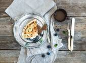 Thin pancake or crepe with fresh blueberry, cream, mint, and salty caramel sauce in vintage metal plate over rustic wooden backdrop — Stock Photo