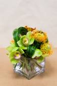 Floral arangement with Calla Lilies, cymbidium, protea and greenery — Stock Photo