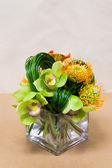 Floral arangement with Calla Lilies, cymbidium, protea and greenery — Photo