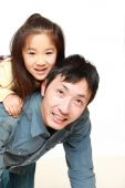 Japanese father and his daughter play horse-ride — Foto de Stock