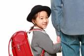 Japanese school girl with satchel walking to school with her father — Stockfoto
