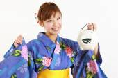 Young woman wearing Japanese kimono with mosquito coil — Stock Photo