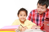 Father helping his daugther doing homework — Stock Photo