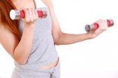 Young woman doing dumbbell exercise — Stock Photo