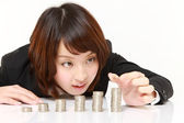 Businesswoman Put Coins To Stack Of Coins — Stockfoto