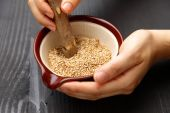 Grinding white sesame seed — Stock Photo