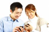 Japanese couple with smart phone — Stock Photo