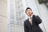 Japanese businessman talks with a mobile phone — Zdjęcie stockowe