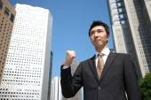 Japanese businessman in a victory pose — Zdjęcie stockowe