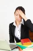 Businesswoman suffers from headache — Stock Photo