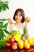 Young Japanese woman with fruits and vegetables — Stock Photo