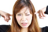Young Japanese woman suffers from noise — Stock Photo