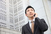 Japanese businessman talks with a mobile phon — Stock Photo