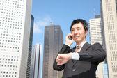 Japanese businessman talks with a mobile phone — Foto de Stock