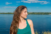 The girl on the bank of the  River. June 2014 — Foto Stock