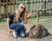 Girl and Ostrich. South Africa. — Stock Photo