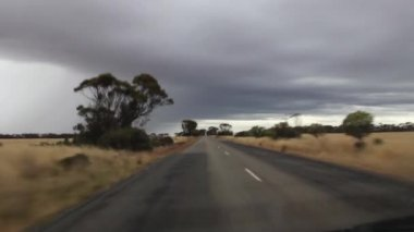 Driving through western Australia with dark clouds and lighting — Stock Video