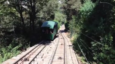 Going down from the San Cristobal Hill passing by a train in Santiago de Chile — Stock Video