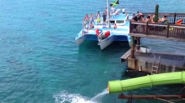 Water slide and sailboat at Margaritaville montego bay Jamaica — Stock Video