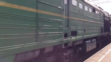 Trans Siberia railway train passing by at a station in Russia — Stock Video