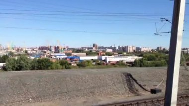 Trans Siberia railway passing by a city in Russia — Stock Video