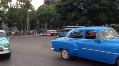 Following a blue and green classic old car in Havana, Cuba — Stock Video