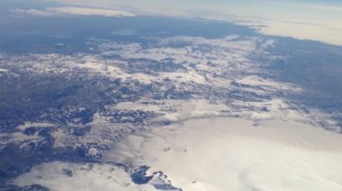 Flying above mountains with snow in Iceland — Stock Video