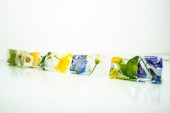 Flowers frozen in ice cubes — Stock Photo