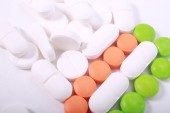 Stack of different pills isolated on white background — Stock Photo