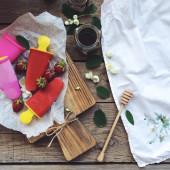 Ice-cream, strawberries and jars of jam — Stock Photo